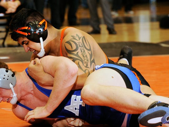 Amarveer Dhesi (top) was named Pac-12 Wrestler of the Year and placed fifth nationally in the heavweight division.