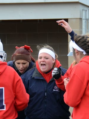 Cleary's Ciara Darkangelo is greeted by teammates after hitting a two-run homer in the fourth inning of Saturday's opener. Darkangelo also drove in a run with a sacrifice fly to account for all of the Cougars' scoring in a game Cleary lost 8-3.