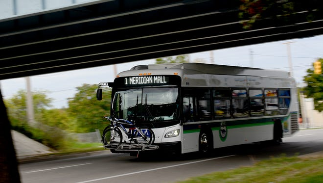 A CATA bus on the No. 1 route heads east on Michigan Avenue toward I-496 Wednesday, Sept. 28, 2016, on its way to the Meridian Mall.