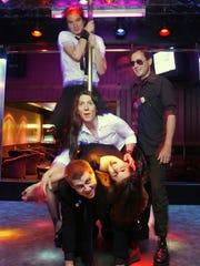 Members of The Funhouse Strippers: David Ballantyne (from the bottom), Crissy Barker, Karen Holman, Johnny Max and Toby Tanabe photographed around a pole at Stars Cabaret on June 4, 2006.