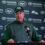 Jets head coach Rex Ryan talks with the media after a game against the Vikings last season.