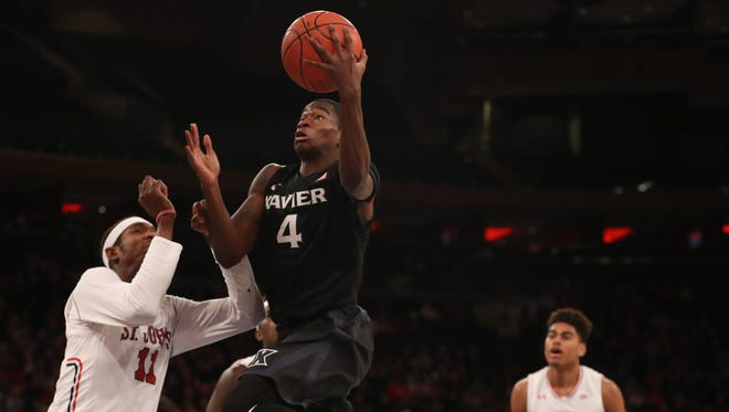 Xavier Musketeers guard Edmond Sumner (4) drives up over St. John's Red Storm forward Tariq Owens (11) during the first half at Madison Square Garden on Jan. 29.