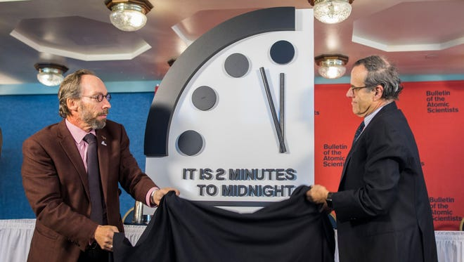 Lawrence Krauss (left), director of the Arizona State University Origins Project, and Robert Rosner (right), professor at the University of Chicago announce that they have adjusted the so-called 'Doomsday Clock' to two minutes to midnight at the National Press Club in Washington, DC, on January 25, 2018.