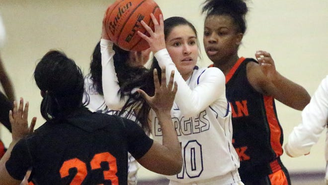 Natalie Sanchez, 10, center, of Burges looks to pass against pressure from Morgan Park.