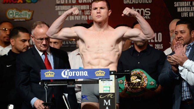 Canelo Alvarez weighs in for his fight against Miguel Cotto at Mandalay Bay. (Joe Camporeale, USA TODAY Sports)
