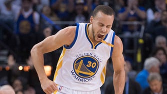 Stephen Curry (30) celebrates against the Cleveland Cavaliers during the first quarter at Oracle Arena.