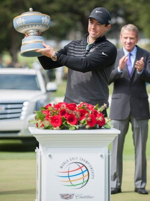 Rory McIlroy holds up the Walter Hagen trophy after winning the 2015 World Golf Championships -Match Play at TPC Harding Park in San Francisco.