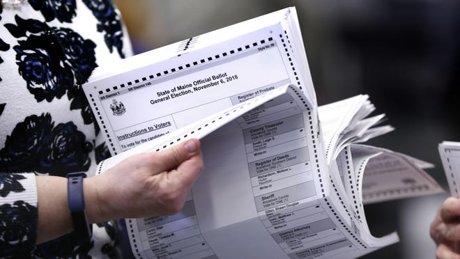 Ballots are prepared to be tabulated for Maine's Second Congressional District's House election Monday, Nov. 12, 2018, in Augusta, Maine. The election was the first congressional race in American history to be decided by the ranked-choice voting method that allows second choices.