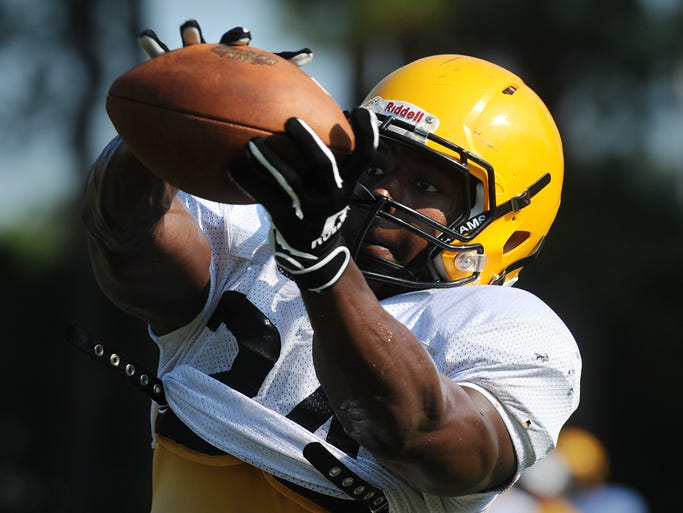Southern Miss running back George Payne (24) pulls in a pass during a football practice Tuesday morning at Joe P. Park Practice Facility.