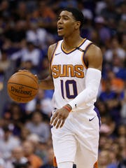 Suns Shaquille Harrison (10) yells to his team during