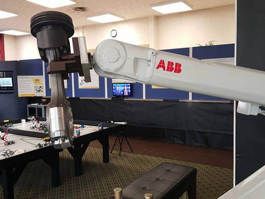 An industrial robot from ABB is part of the exhibit.