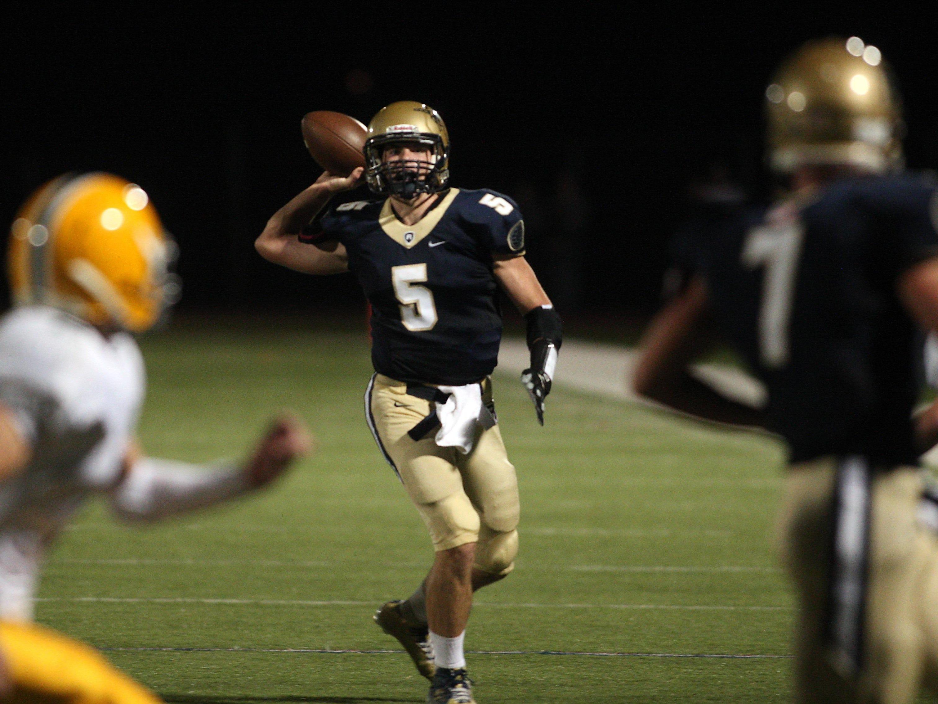 Roxbury quarterback Grant Dixon throws vs Morris Knolls during their football Friday night matchup. September 25, 2015, Roxbury, NJ.