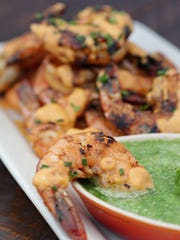 Baste your shrimp with tomato butter while cooking, then serve them with a tomatillo salsa.