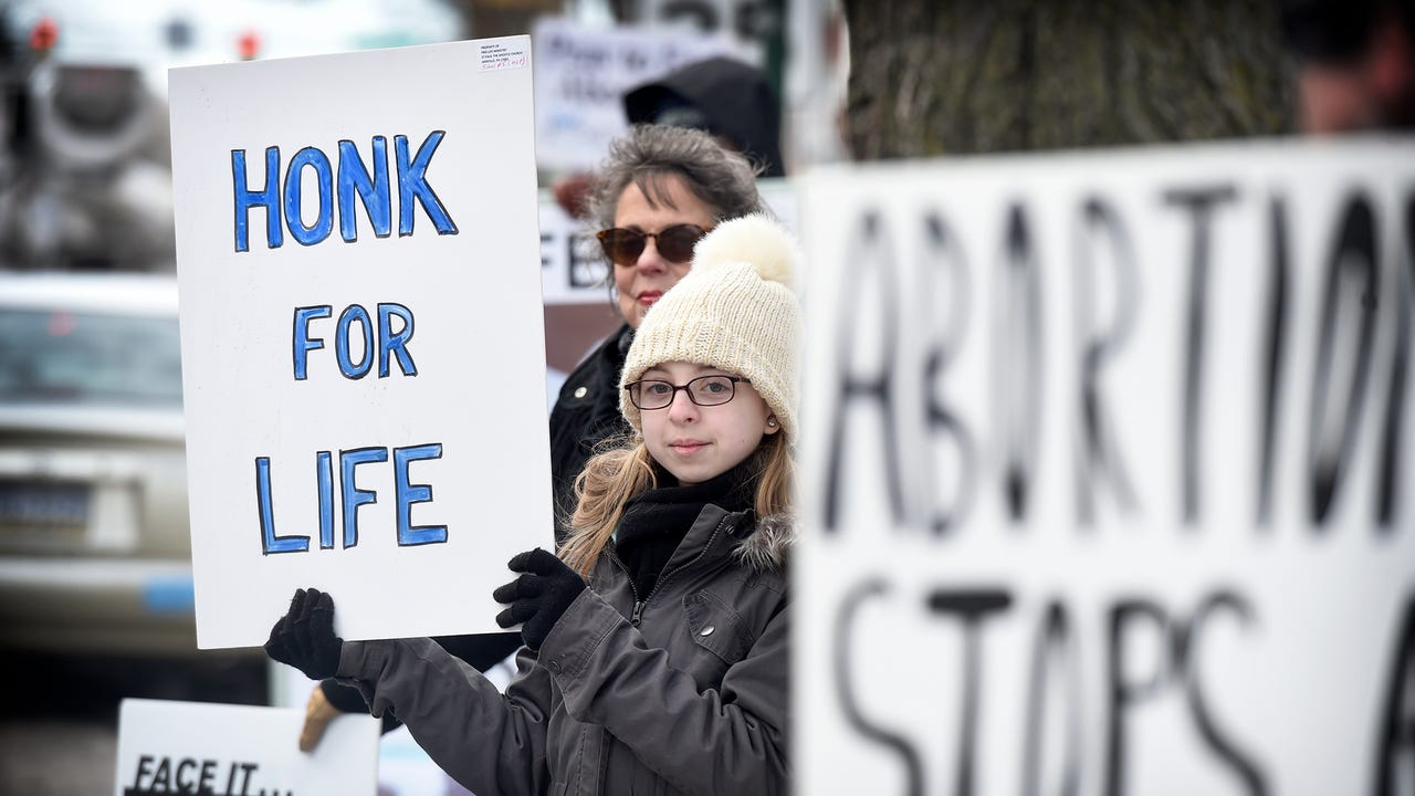 A local event coordinated with the March for Life in DC. Anti-abortion protesters gathered at 8th & Cumberland Friday afternoon, Jan. 18 to bring awareness to the the issue of abortion. This is some conversations with people holding signs.