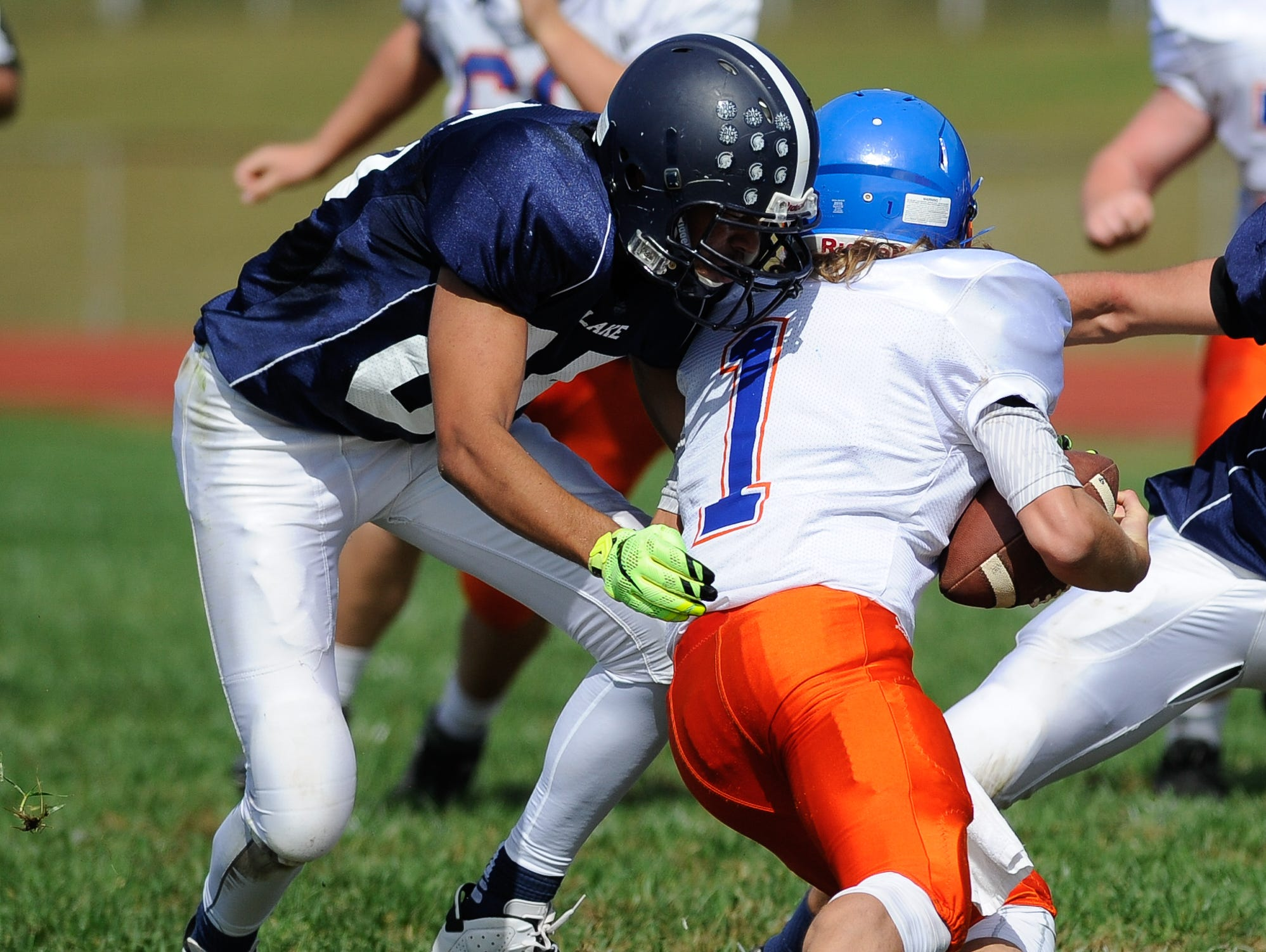 Lake Forest's #85 Cameron Lewis with a tackle on Delmar's quarterback #1 James Adkins on Saturday at Lake Forest High School.