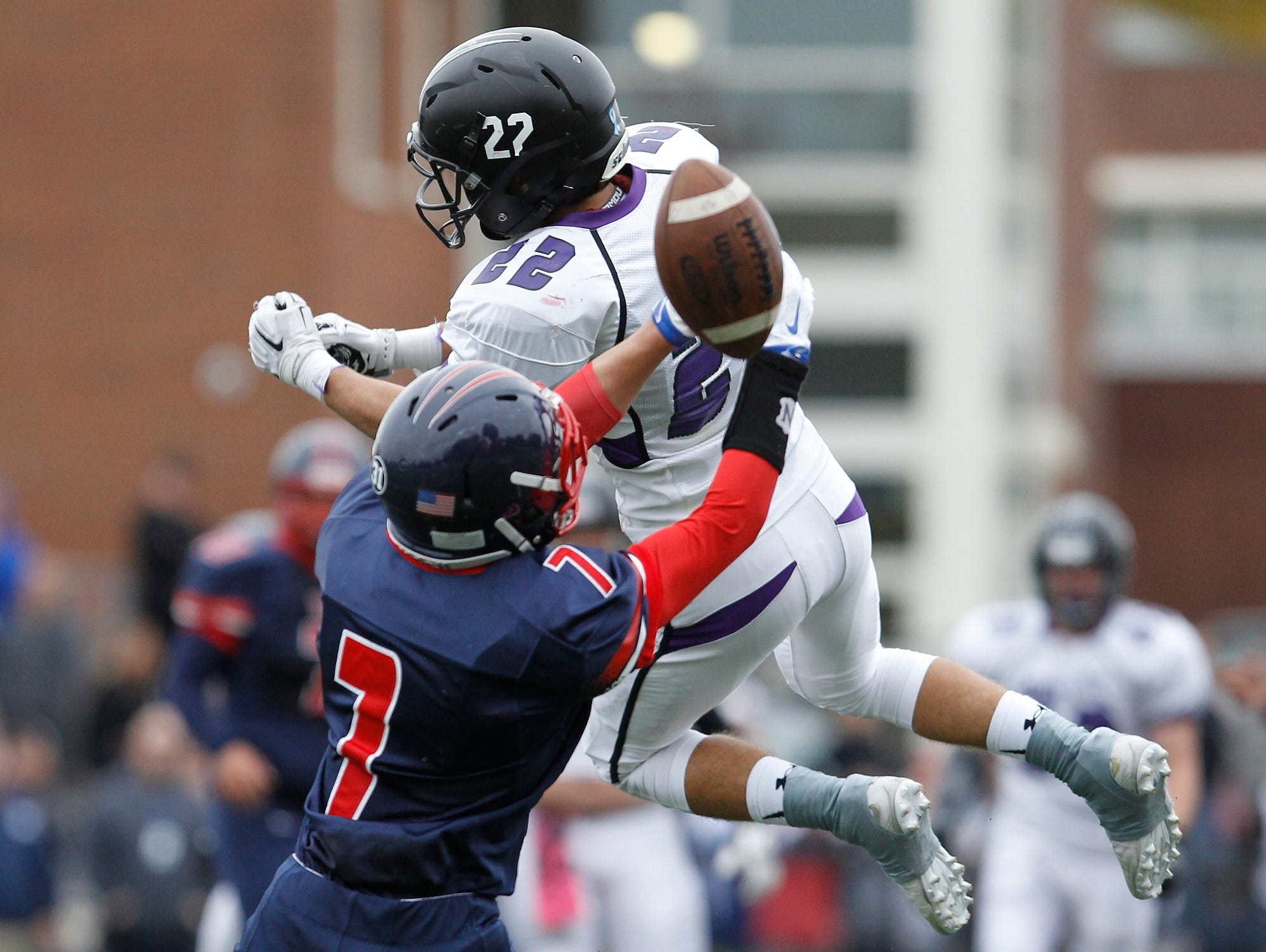 Eastchester's Jacob Risi (7) breaks up a pass intended for John Jay's Jackson Reiger (22) during a varsity football game at Eastchester High School on Saturday, Oct. 24, 2015.