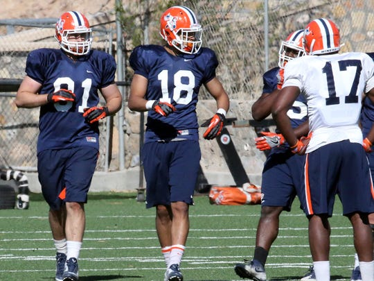 UTEP senior tight end Sterling Napier, 81, and junior transfer tight end David Lucero, 18, run plays during spring practice at Glory Field.