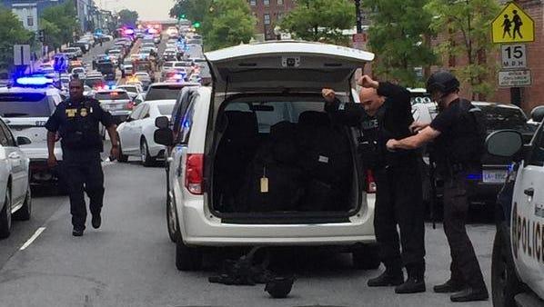 Police gear up and run toward the scene at Navy Yard in Washington, D.C., on Thursday.