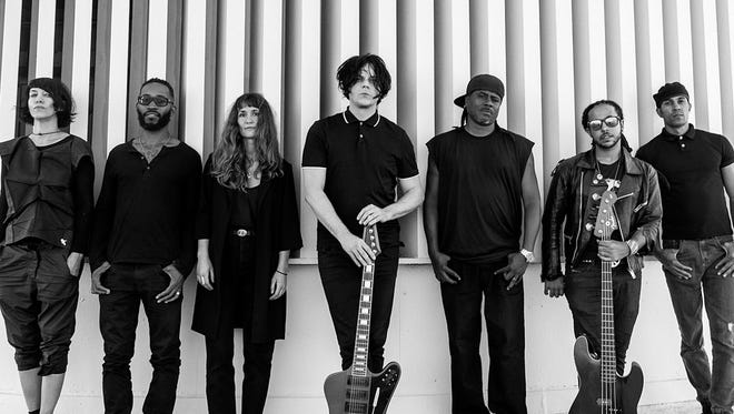 Jack White poses in Los Angeles with the musicians he's recording with for his third solo album.