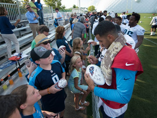 Titans quarterback Marcus Mariota (8) signs autographs for fans,  following a training camp practice at Saint Thomas Sports Park.