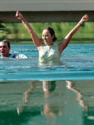 2004 Kraft Nabisco Championship champion Grace Park celebrates with her caddie David Brooker after jumping in the water at the Mission Hills Country Club in Rancho Mirage.