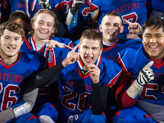 Hartford players celebrate their victory over St. Johnsbury