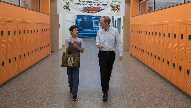 Microsoft president and Brad Smith walks with Silverland student Sky Yi.