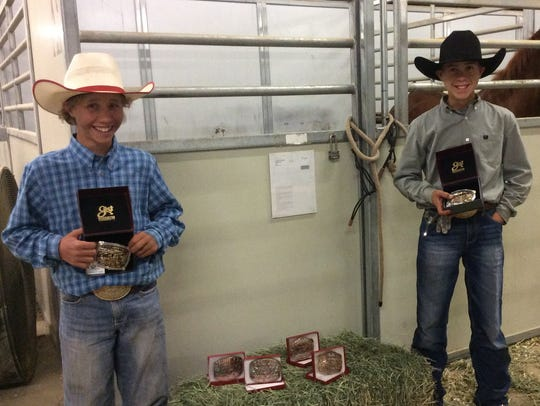 Brothers Caden and Cameron Drake show off buckles won