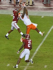 In the CFP title win over Alabama, Clemson's Mike Williams catches a jump ball that was reminiscent of some of the grabs Devin Smith made during Ohio State's national championship run in 2014. The Buckeyes could have used either receiver this season.