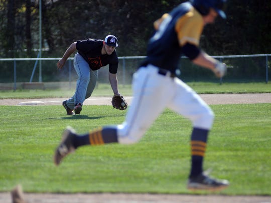 Marine City third baseman Mike Heck scoops up a ground