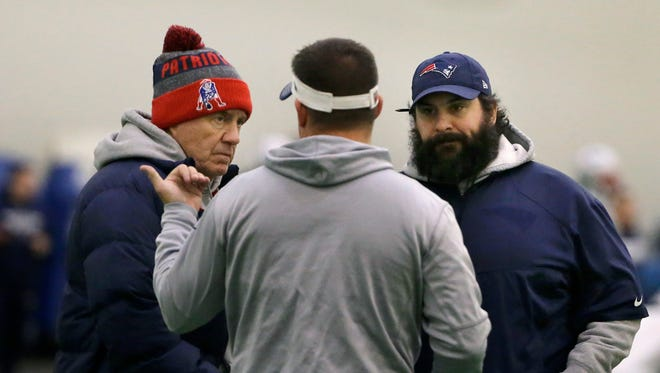 New England Patriots head coach Bill Belichick, left, and defensive coordinator Matt Patricia, right, speak with offensive coordinator Josh McDaniels, center, during practice, Dec. 13, 2017 in Foxborough, Mass.
