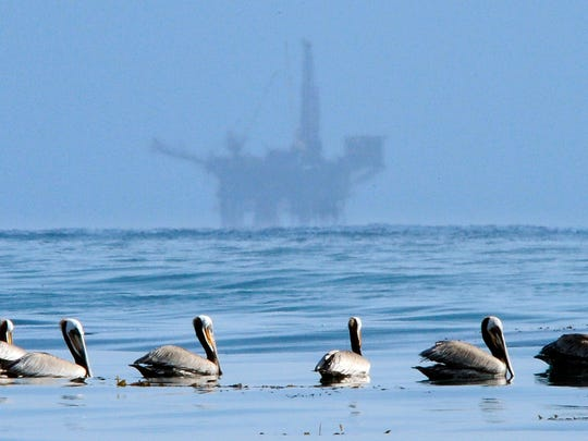 In this May 13, 2010 file photo, pelicans float on the water with an offshore oil platform in the background in the Santa Barbara Channel off the coast of Santa Barbara, Calif. The Trump administration on Thursday, Jan. 4, 2018 moved to vastly expand offshore drilling from the Atlantic to the Arctic oceans with a plan that would open up federal waters off the California coast for the first time in more than three decades. The Channel is one of those areas.