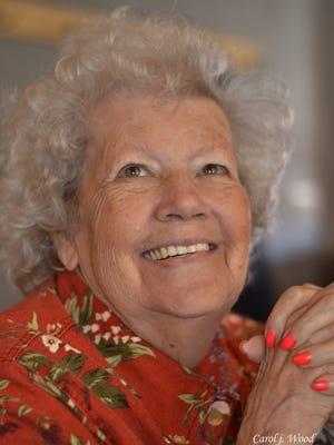 Mikki Kipp, of Vestal, with her fingernails painted her favorite color: orange.