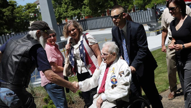 Don Malarkey, a member of the original Band of Brothers, arrives. Hundreds of veterans and their supporters gather for the dedication of the Oregon World War II Memorial at Willson Park on the grounds of the State Capitol.