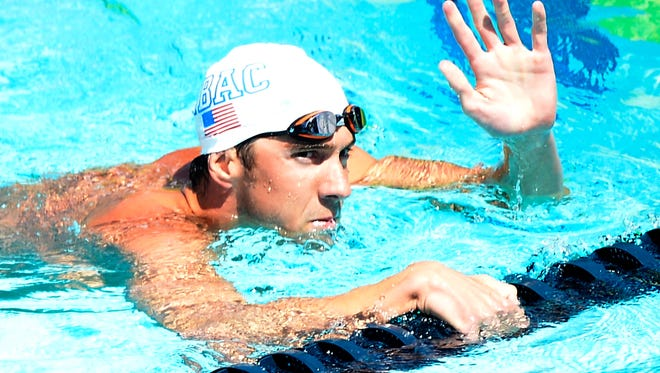Michael Phelps qualifies first in the 100-meter butterfly on Friday at the U.S. national championships.