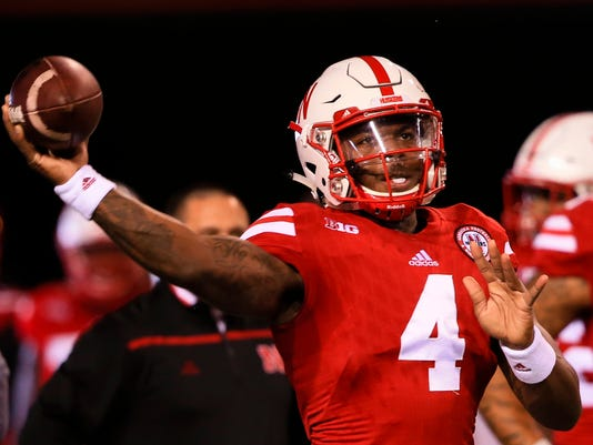 Nebraska quarterback Tommy Armstrong Jr. (4) throws before an NCAA college football game against Michigan State in Lincoln, Neb., Saturday, Nov. 7, 2015. (AP Photo/Nati Harnik)