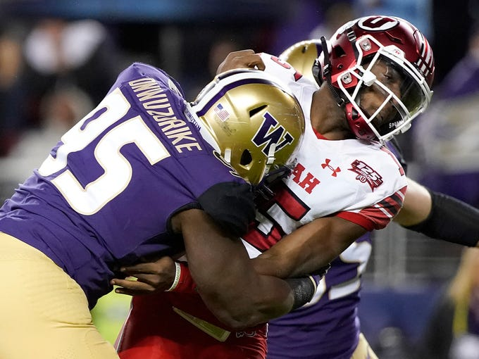Washington defensive lineman Levi Onwuzurike (95) hits Utah quarterback Jason Shelley after Shelley threw a pass during the first half of the Pac-12 Conference championship NCAA college football game in Santa Clara, Calif., Friday, Nov. 30, 2018. (AP Photo/Tony Avelar)