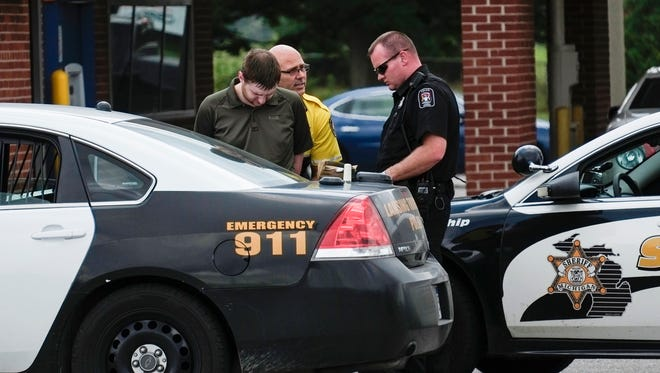 Eaton County Sheriff deputies and Lansing Township officers take into custody a man suspected of being involved with a kidnapping Monday, Aug. 21, 2017. Andrew John Spagnuolo, 20, faces felony counts of unlawful imprisonment, carrying a concealed weapon in an auto and felony firearm possession, court records show.