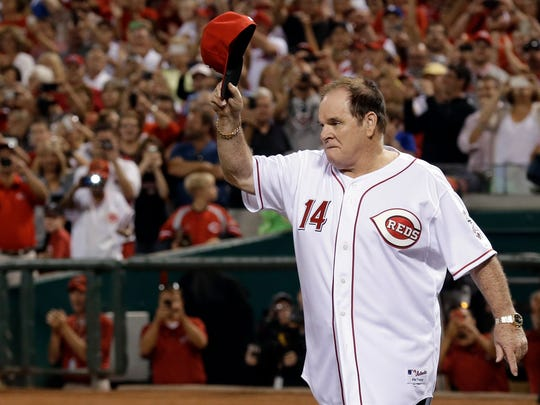 FILE - In this Sept. 6, 2013, file photo, former Cincinnati Reds great Pete Rose walks onto the field during ceremonies honoring the starting eight of the 1975-76 World Series-champion Reds.