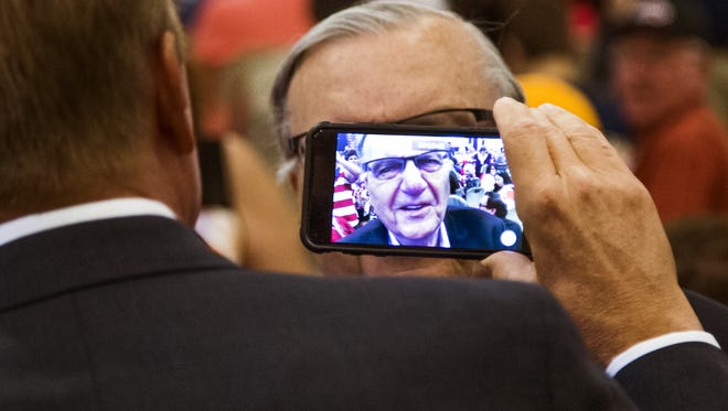 Former Maricopa County Sheriff Joe Arpaio is interviewed before a speech by Vice President Mike Pence at the America First Policies event at the Phoenix Marriott Resort Tempe at the Buttes on May 1, 2018. The 9th U.S. Circuit Court of Appeals rebuffed a Maricopa County argument that it was not liable for the racial-profiling traffic-stop policies of Arpaio, which have already cost the county millions.