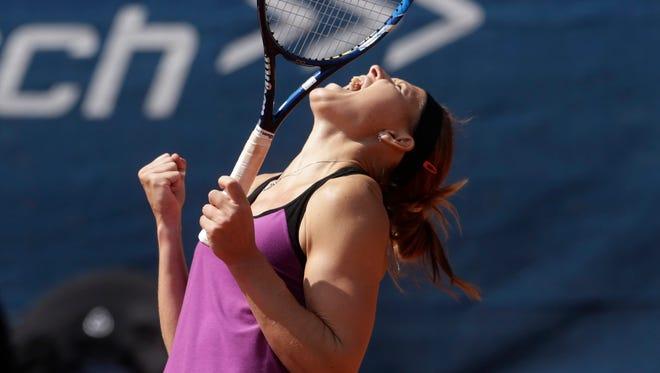 Safarova celebrates after defeating Samantha Stosur.