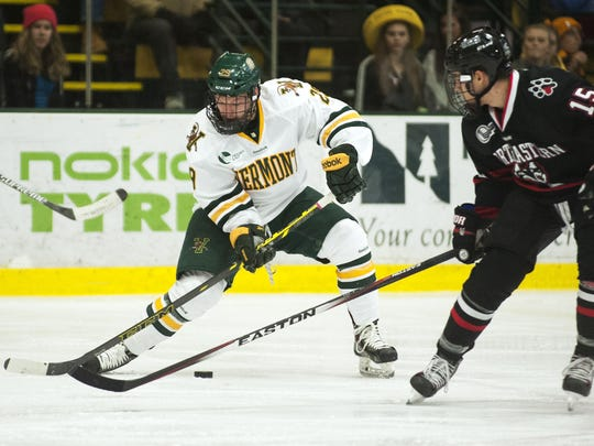 Catamounts forward Anthony Petruzzelli (28) plays the puck during the men's hockey game between the Northeastern Huskies and the Vermont Catamounts at Gutterson Fieldhouse on Friday night.
