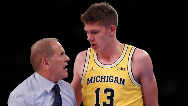 Michigan center Moritz Wagner and coach John Beilein talk during a 76-54 win over SMU on Friday, Nov. 18, 2016 in New York.
