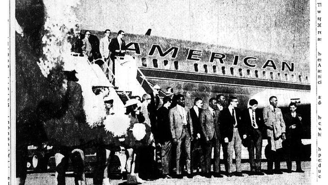 BOUND FOR FINALS - Flanked by Texas Western Golddiggers, The Miner basketball team bids farewell to El Paso fans as the Midwest NCAA champs left for College Park, Md. and the NCAA finals.