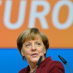 This file photo taken on Dec. 13, 2015 shows German Chancellor and Christian Democratic Union (CDU) leader Angela Merkel inspecting the location for the CDU's party congress in Karlsruhe, southwestern Germany.