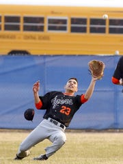 Union-Endicott center fielder Dominick Cataldo tries to make a diving catch during a 14-2 loss at Horseheads on April 13.