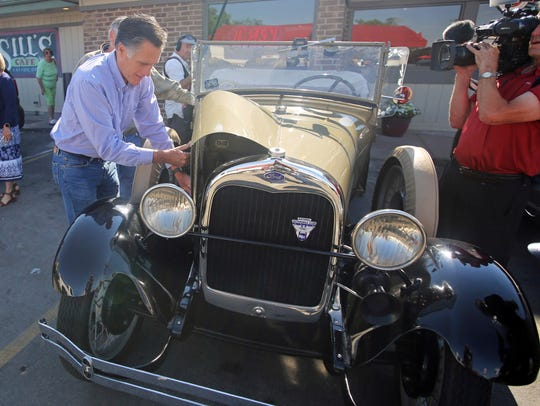 Mitt Romney looks under the hood of a 1928 Model A Ford Roadster following a campaign breakfast stop at Sill's Cafe on June 26, 2018, in Layton, Utah.
