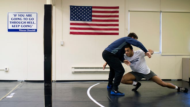 Camden County College wrestler Dymere Rappa, right, runs drills with teammate Ian Lyach for a portrait inside the practice gym Monday, Feb. 29 in Blackwood.