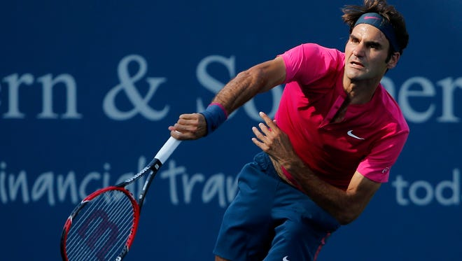 Roger Federer, of Switzerland, serves to Andy Murray, of the United Kingdom, in the second set during their semifinal match, Saturday, Aug. 22, 2015, at the Lindner Family Tennis Center in Mason, Ohio.
