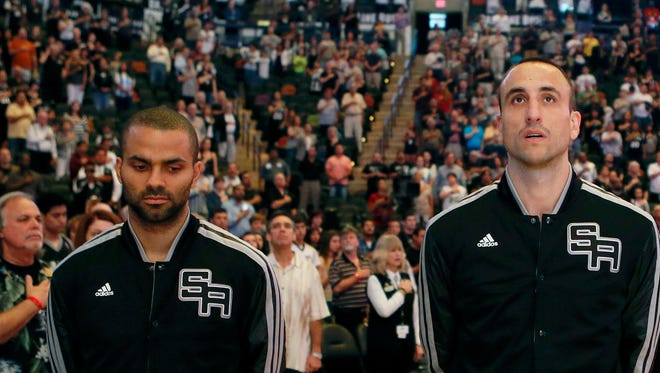 Tony Parker (left), and Manu Ginobili (center), teammates in San Antonio, have both retired from international basketball.